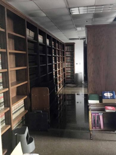 After walls and a section of roof were torn away, wind-driven rain caused severe water damage throughout the courthouse in Lake Charles, leaving standing water in the library.
