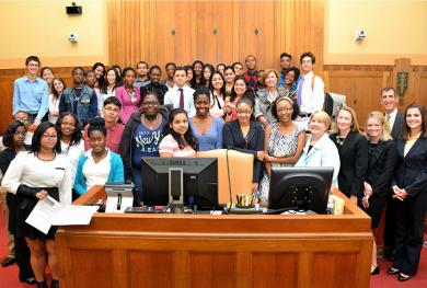 Students and program volunteers following a mock bankruptcy hearing in Boston.