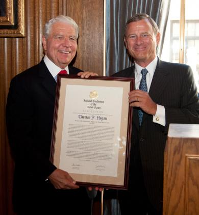 Judge Thomas F. Hogan Receives the Judicial Conference resolution from Chief Justice John Roberts Jr.
