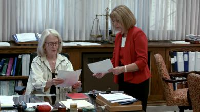 U.S. District Judge Janet Arterton, left, and Clerk of Court Robin Tabora look at documents.