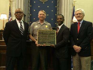 National Park Service presents plaque to Frank M. Johnson Jr. Federal Building and U.S. Courthouse in Montgomery, Alabama on July 20, 2015.