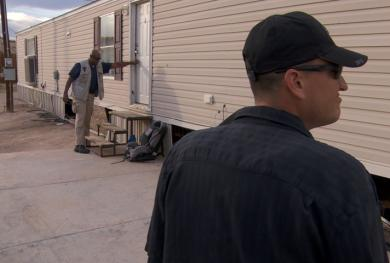 Probation officers conduct a home visit.