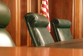 Fourth Circuit Court of Appeals courtroom showing three chairs.