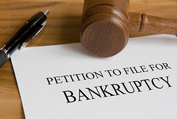 A representation of paperwork to file for bankruptcy.