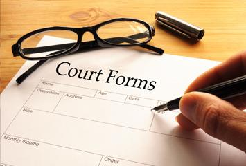Filling in a court form.
