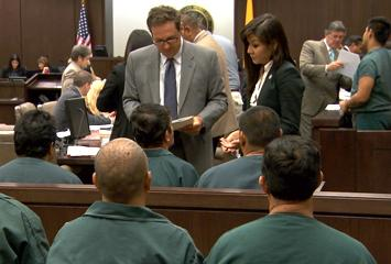image of attorneys meeting with defendants before a hearing