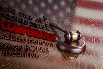 A gavel on the U.S. flag with words related to judge's compensation.