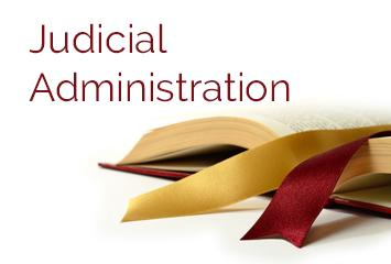 An open book with a bookmark is used to symbolize Judicial Administration and oversight.