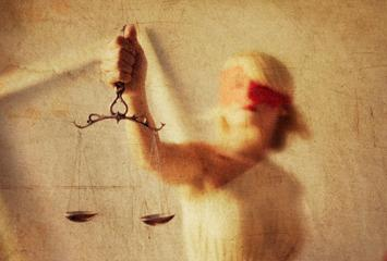 Lady justice holds the scales of justice in this visual representation.
