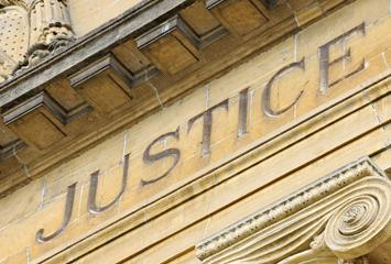 "image of the word ""Justice"" on a federal court building"