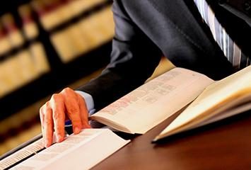 An image of a man researching various judicial resources for information.