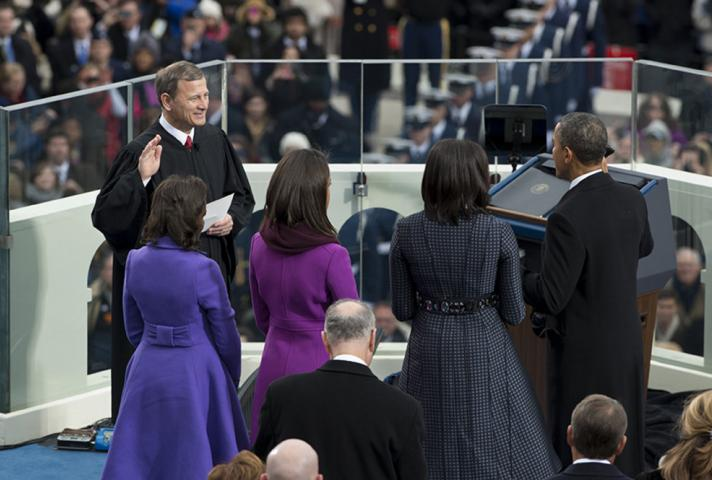 Chief Justice John G. Roberts Jr. administers the public oath of office to President Obama, as the president's wife and daughters watch.