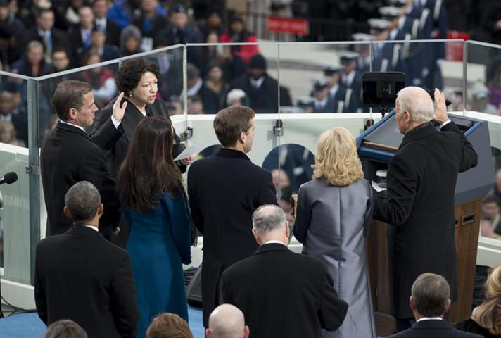 Associate Justice Sonia Sotomayor swears in Vice President Biden, with his family looking on.