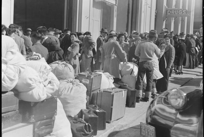 In San Francisco, Japanese Americans wait for train to internment camps.