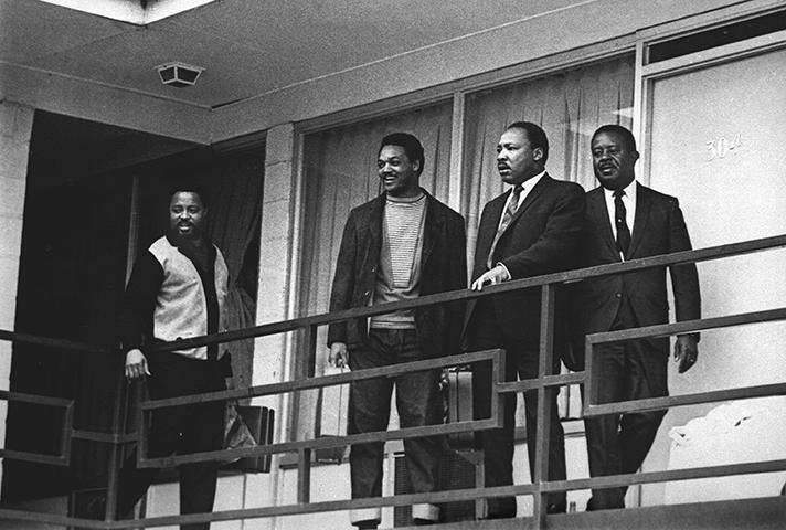 Shortly before he was slain on April 4, 1968, Martin Luther King, Jr., is flanked outside his motel room by Jesse Jackson and Ralph Abernathy.