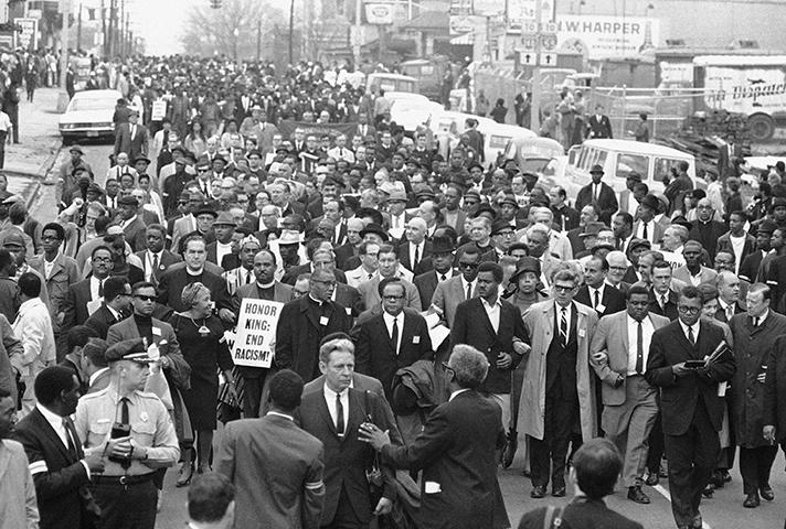 On April 8, grieving followers gather for the march Martin Luther King, Jr., had planned to lead.