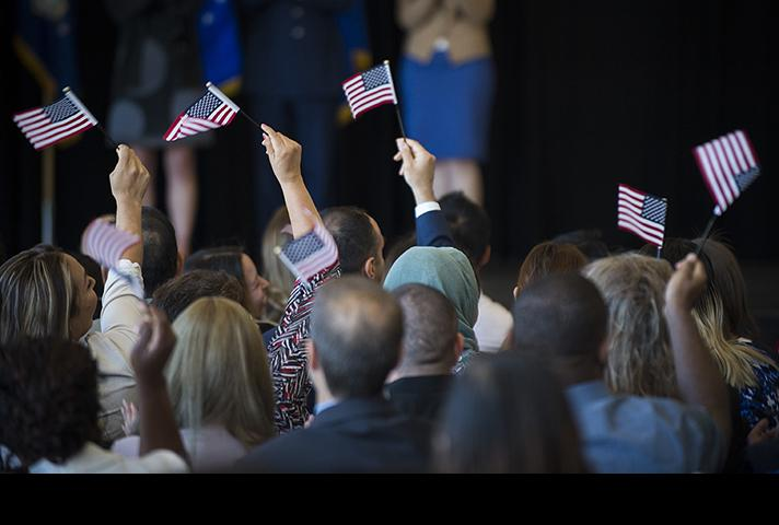 Flags waving during naturalization ceremony.
