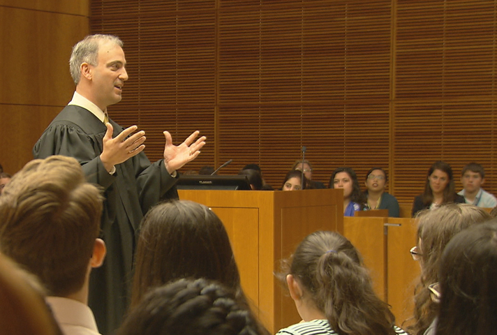 Judge speaking to students during Justice Institute