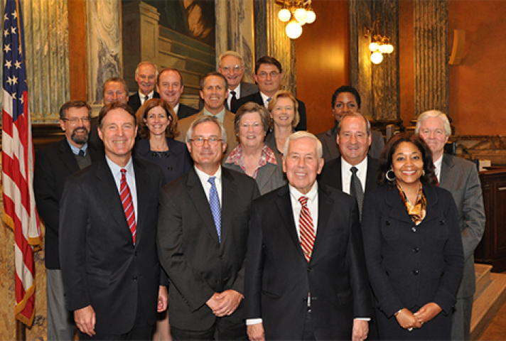 Former Senator Evan Bayh (front row left) and Senator Richard Lugar (front row, second from right) met with the judges in Indianapolis.