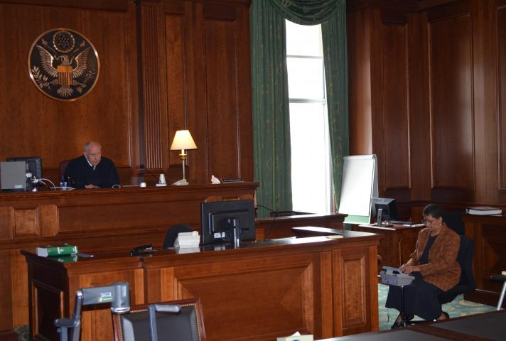 U.S. District Judge P. Kevin Castel presided over a time-sensitive international abduction case in the Moynihan Courthouse, which lost power due to the storm, using a temporary table lamp and natural sunlight to light the courtroom.