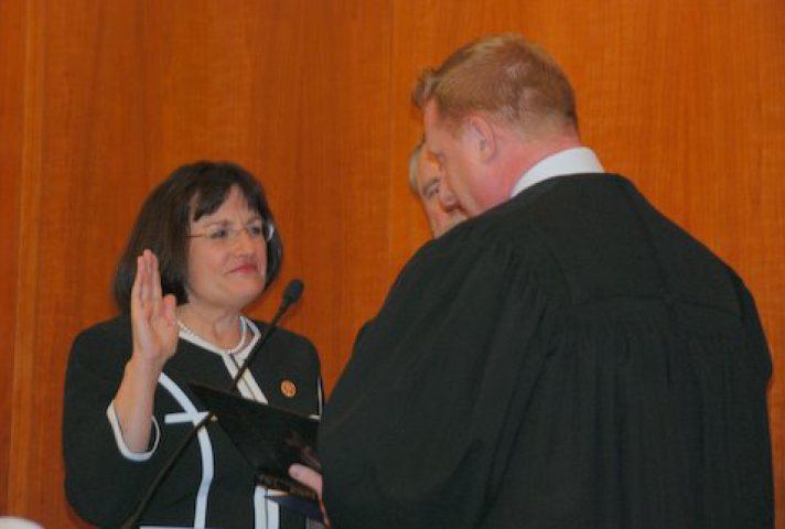 Rep. Ann McLane Kuster (D-NH) is sworn in by Chief Judge Joseph N. Laplante, of the District of New Hampshire.