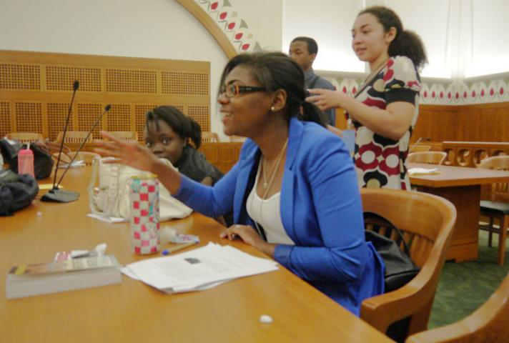 Nelson Fellows practice for a mock trial in a courtroom.
