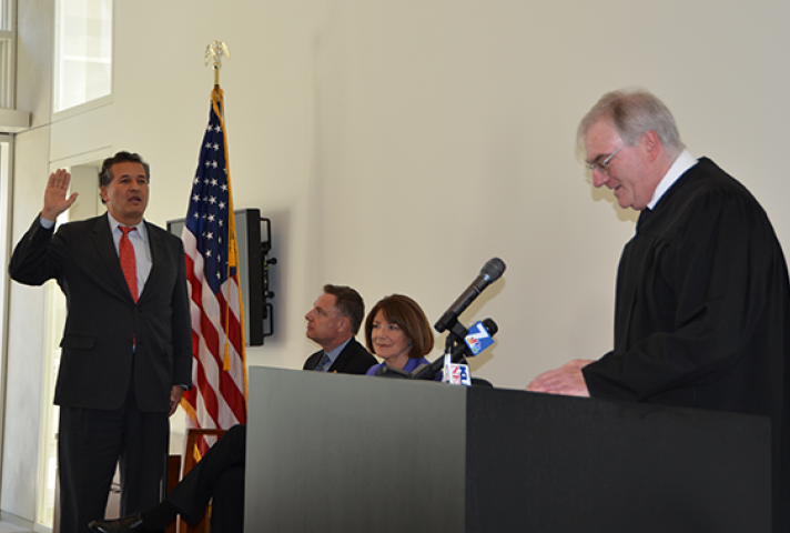 Chief Judge Barry Ted Moskowitz, of the Southern District of California, swears in Rep. Juan Vargas (D-CA).