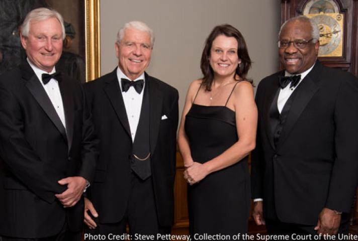 AO Director Thomas F. Hogan, second from left, is flanked by the committee that gave him the Devitt Award. From left, they are Joel F. Dubina, chief judge of the U.S. Court of Appeals for the Eleventh Circuit; Lisa Godbey Wood, chief judge of the U.S. Dis