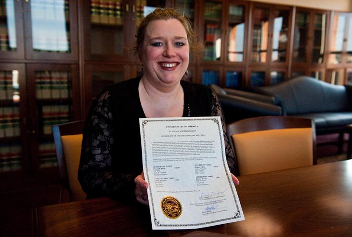 Miriam Vincent, a staff attorney for the National Archives and Records Administration, holds a certificate ascertaining South Dakota's 2012 electors.