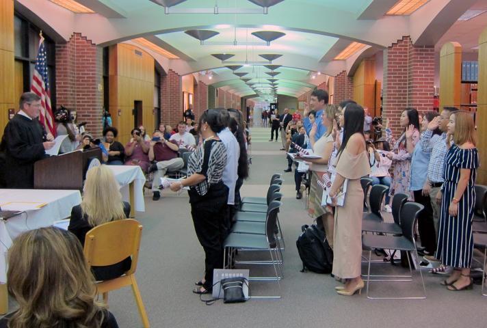 New citizens take oath at naturalization ceremony in Lafayette, La.