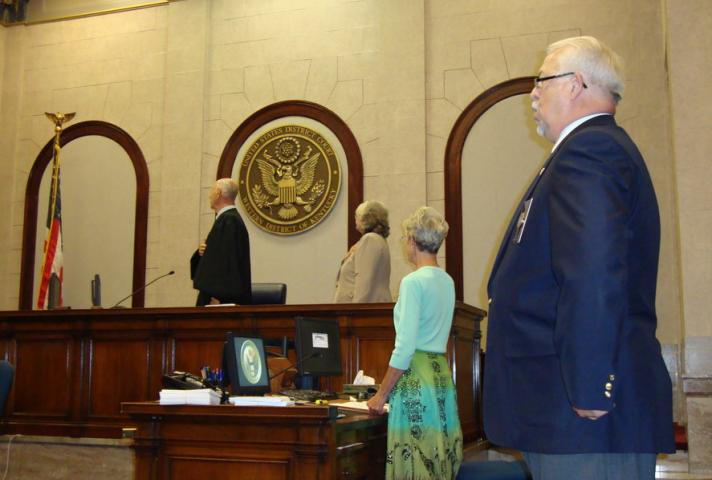 Federal judges conduct naturalization ceremonies -- usually in federal courthouses.