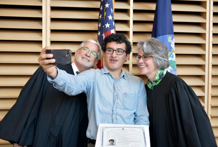 Judges in Maine take selfie with new citizen.