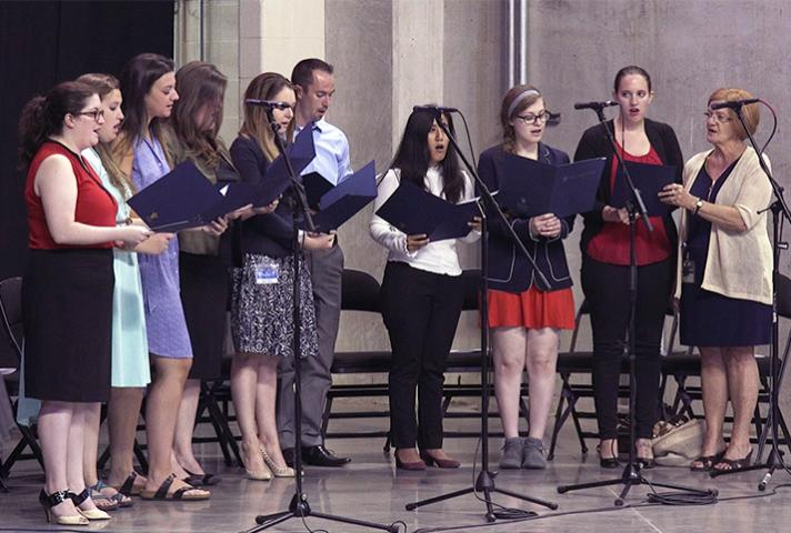 Saint Louis University law school choir sings.