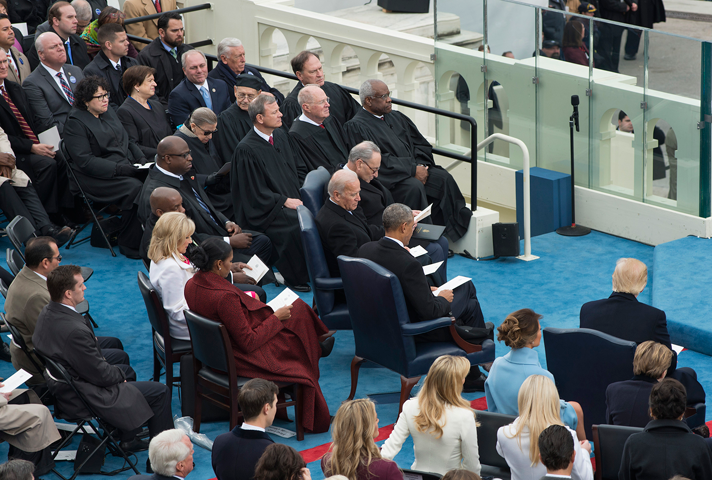 U.S. Supreme Court justices seated on the presidential platform.