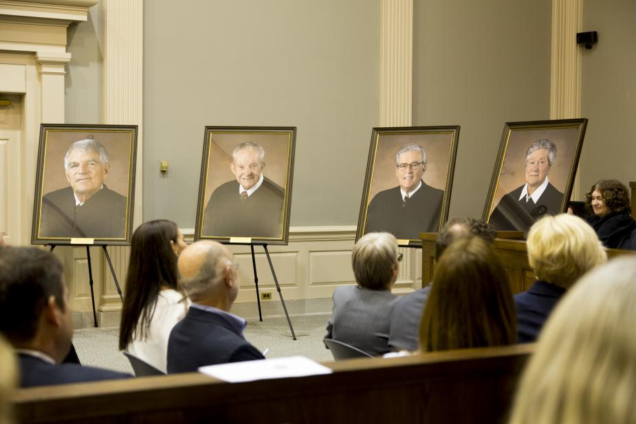 Portraits of retired Magistrate Judges Arthur H. Latimer, F. Owen Eagan, Thomas P. Smith, and Holly B. Fitzsimmons are unveiled at the Richard C. Lee Courthouse in New Haven.