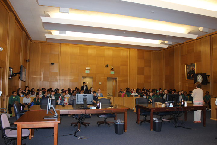Renee Alexander (far right) speaks to students in Hartford, Connecticut, about how a courtroom functions. Alexander is judicial assistant and courtroom deputy to Senior District Judge  Alfred V. Covello.