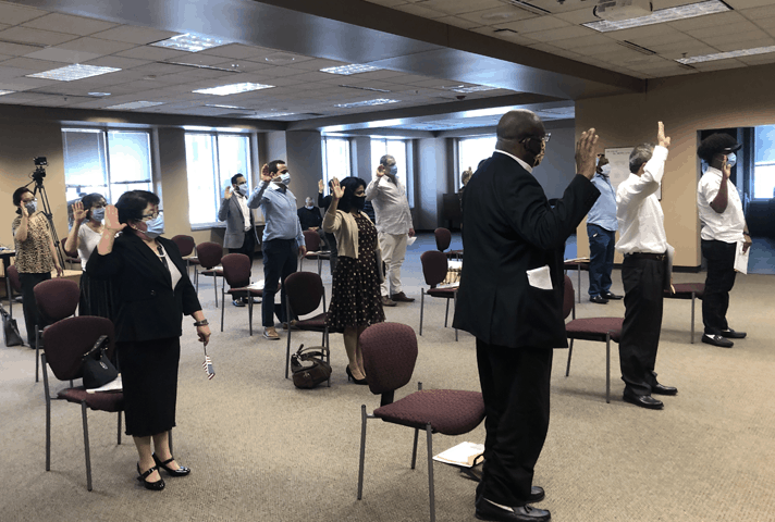 Citizens take the Oath of Allegiance to the United States during a ceremony at the federal courthouse in Kansas City, Kansas.