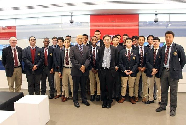 U.S. Court of Appeals Judge Robert A. Katzmann, center-right, and U.S. District Judge Victor Marrero, center-left, pose for a picture with high school students at the learning center in New York.