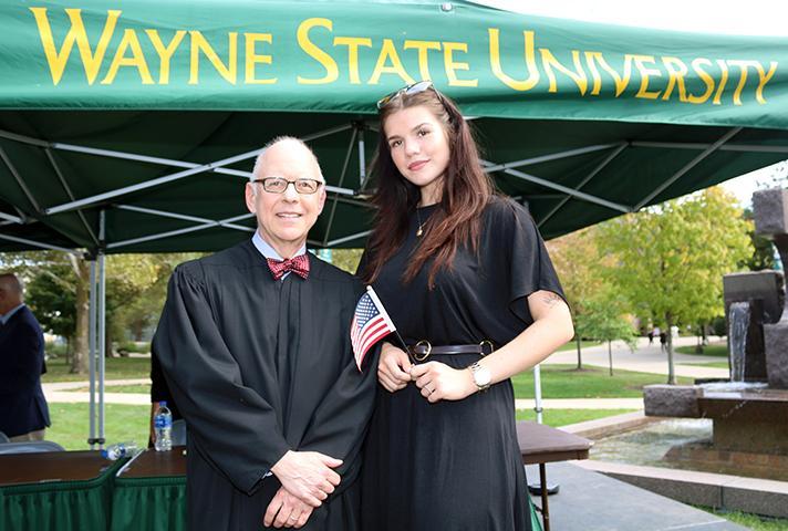 U.S. District Court Judge Mark A. Goldsmith with new citizen Xenya Burdo.