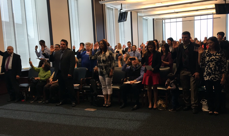 New citizens are sworn in at a federal courthouse ceremony in Cleveland.