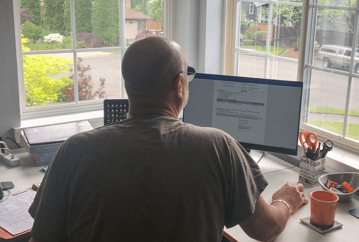 Probation officer in the Western District of Washington reviews the court's judgment on a case  while working remotely from his home