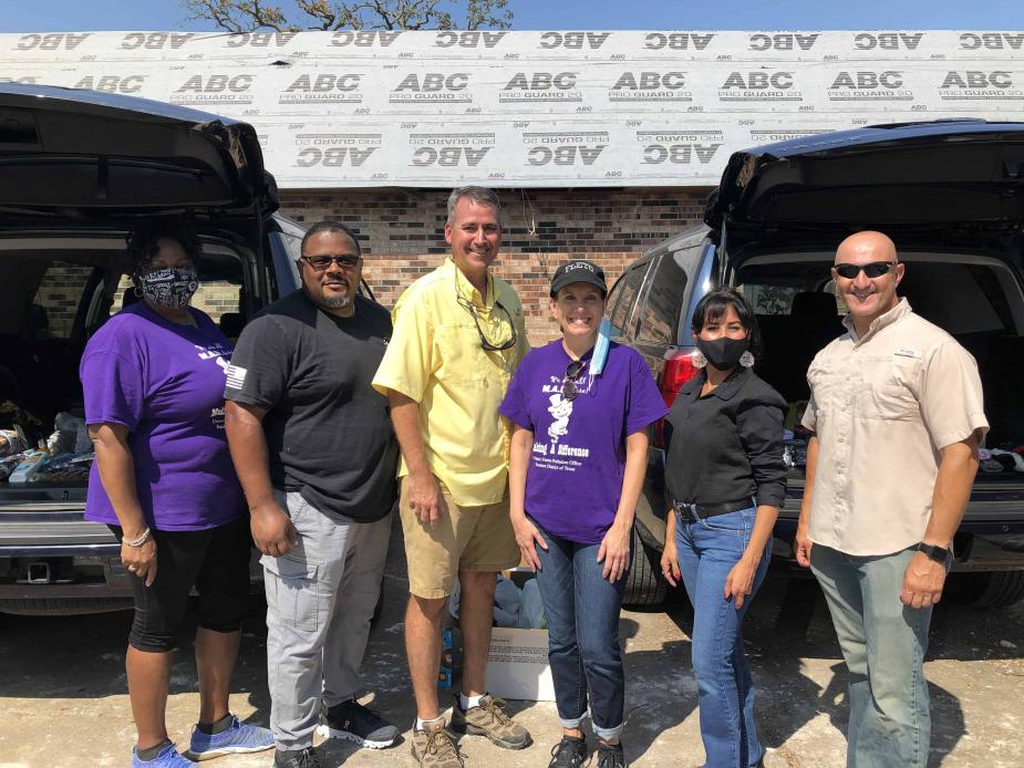 Probation staff from three districts participated in a clothing and supplies giveaway in Lake Charles. From left: Myra Kirkwood, Chief U.S. Probation Officer, Eastern District of Texas; Clint Mitchell, Deputy Chief U.S. Probation Officer, Western District