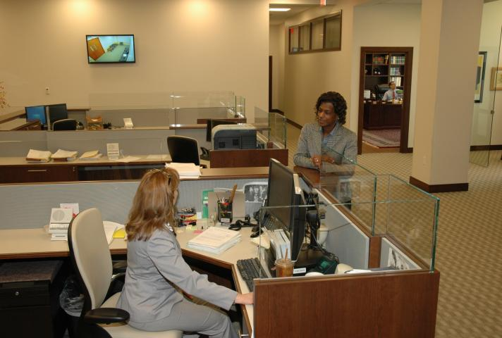 Two women speaking in an open central office space
