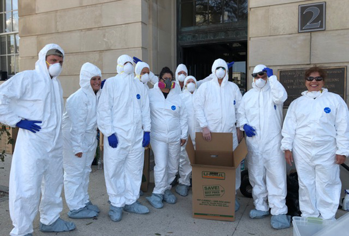 Image: Staff from the North Carolina Eastern Probation and Pretrial Services Office wore protective clothing as they entered the mold ridden courthouse in Wilmington.