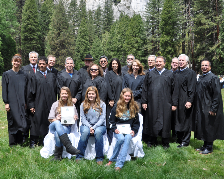 At a Yosemite Valley ceremony, student essay contest winners are flanked by 16 federal and state judges.