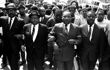 Martin Luther King, Jr., leads a sanitation workers' protest that dissolved into vandalism.