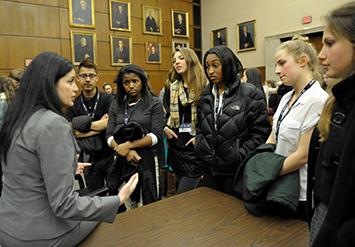 Attorney with students in courtroom